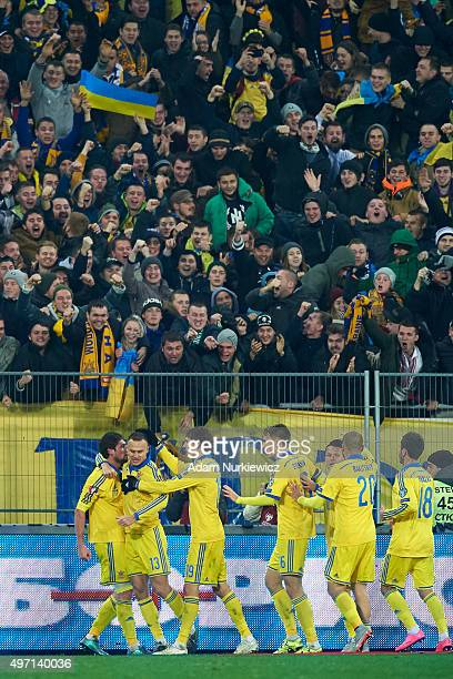Yevhen Seleznyov of Ukraine celebrates with team mates after scoring during the UEFA EURO 2016 Playoff for Final Tournament First leg between Ukraine...
