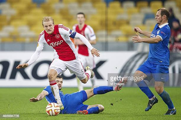 Yevhen Shakhov of FC Dnipro Dnipropetrovsk Nicolai Boilesen of Ajax Roman Zozulya of FC Dnipro Dnipropetrovsk during the Europa League round of 16...