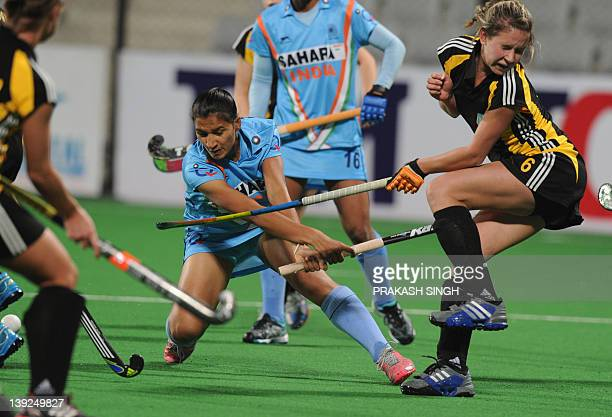 Yevheniya Kernoz of Ukraine tries to block a shot by Rani Rampal of India during the women's hockey match between India and Ukraine of the FIH London...