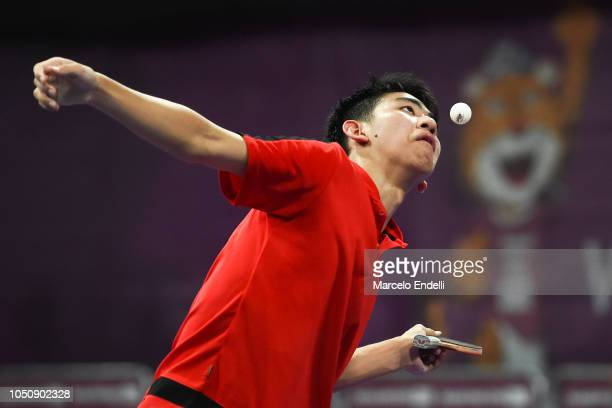 Yew En Koen of Singapore hits a return against Azeez Solanke of Nigeria during the men's singles preliminary stage match on day 1 of the Buenos Aires...