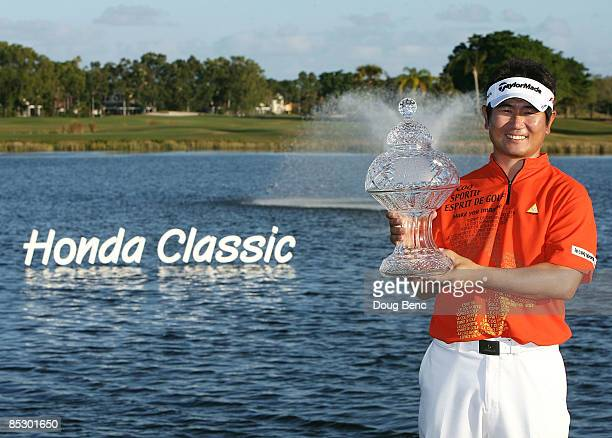 Yang celebrates with the trophy after winning The Honda Classic at PGA National Resort and Spa on March 8 2009 in Palm Beach Gardens Florida