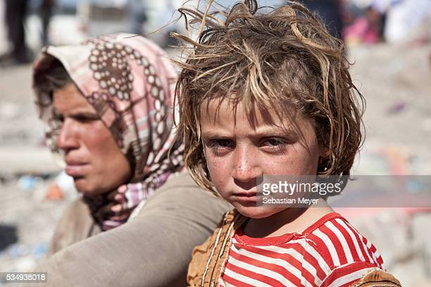 Yezidi girls after crossing from Syria back into Iraq Tens of thousands of Yezidian minority ethnoreligious group in Iraqhave made there way to...