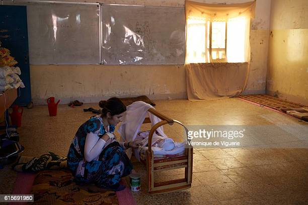 Yezidi refugee just gave birt 2 days ago to a bbay boy She took shelter with other families in a school in Dohouk Many women and young girls were...