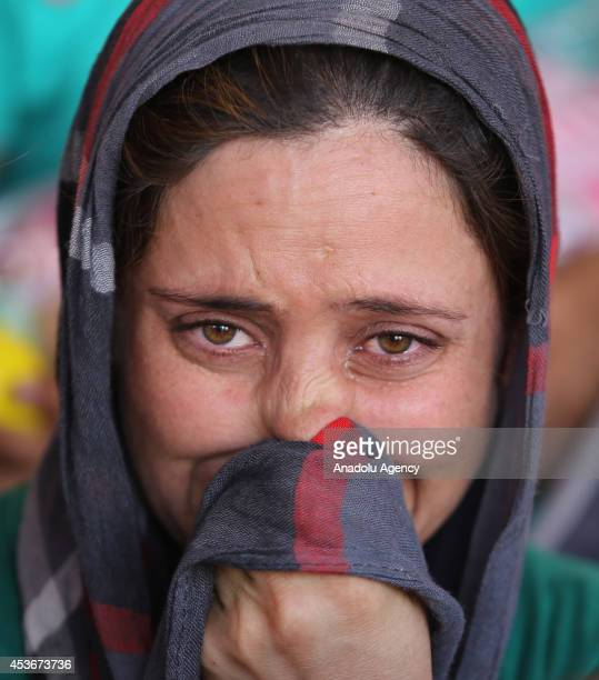 Yezidi woman Bese Hidir talks in tears after Iraqis escaping from attacks of army groups led by Islamic State take shelter in Viransehir district of...