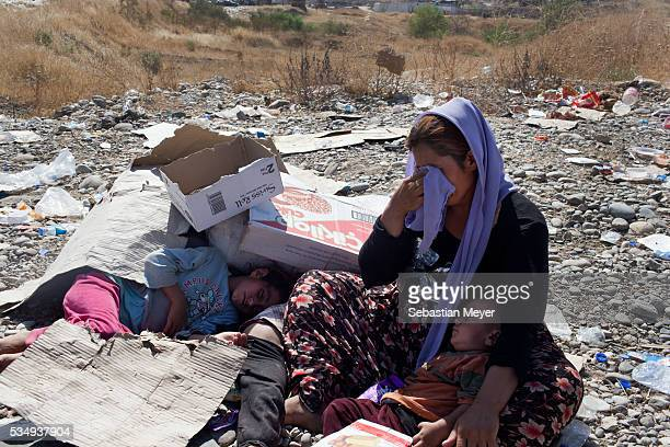 Yezidi woman breaks down in tears after crossing from Syria back into Iraq. Tens of thousands of Yezidi--an minority ethno-religious group in...