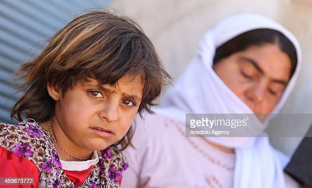 Yezidi woman Gevri Qasim talks in tears after Iraqis escaping from attacks of army groups led by Islamic State take shelter in Viransehir district of...