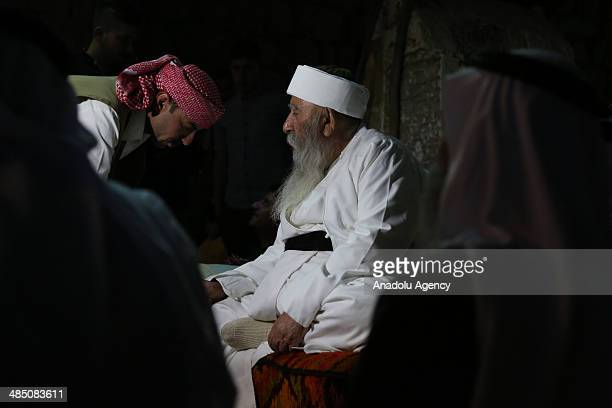 Yezidis kiss Baba Sheikh's hand as they celebrate their New Year in Dohuk, Iraq, on April 16, 2014. The ceremony started in Lalish Temple, the main...