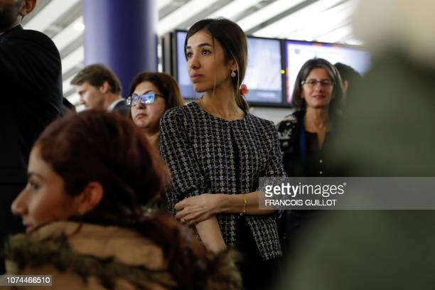Yezidi's Nobel Peace Prize laureate Nadia Murad looks on at the Roissy airport on December 20 2018 as 16 Yezidis women and their children are...
