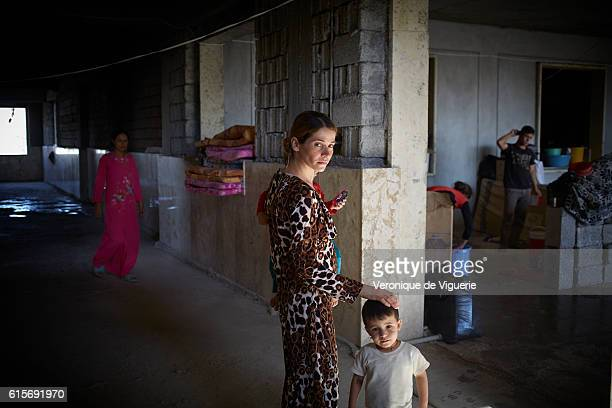 Yezidis refugees in Dohouk are investigating everywhere in the city Here in a school being built