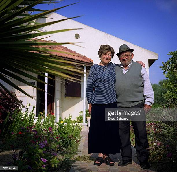 Yhoda Gross and Miryam Gross stand in front of the house they have lived in for the past 18 years June 12 2005 in the Neve Dekalim settlement in Gush...