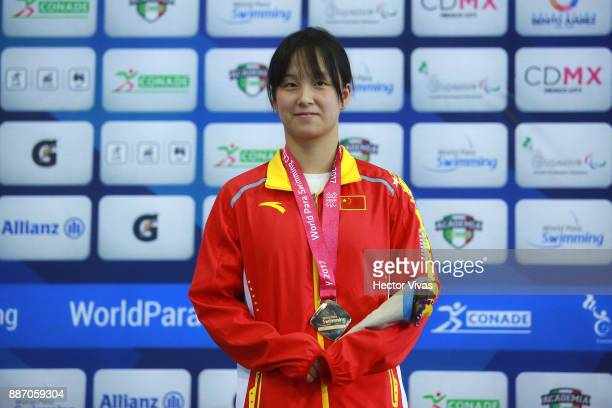 Yi Chen of People's Republic of China smiles with her gold medal in Women's 200 m Individual Medley SM10 during day 3 of the Para Swimming World...