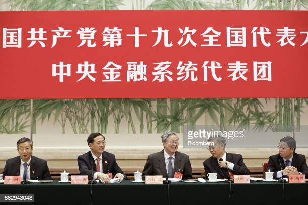 Yi Gang deputy governor of the People's Bank of China from left Liu Shiyu chairman of the China Securities Regulatory Commission Zhou Xiaochuan...