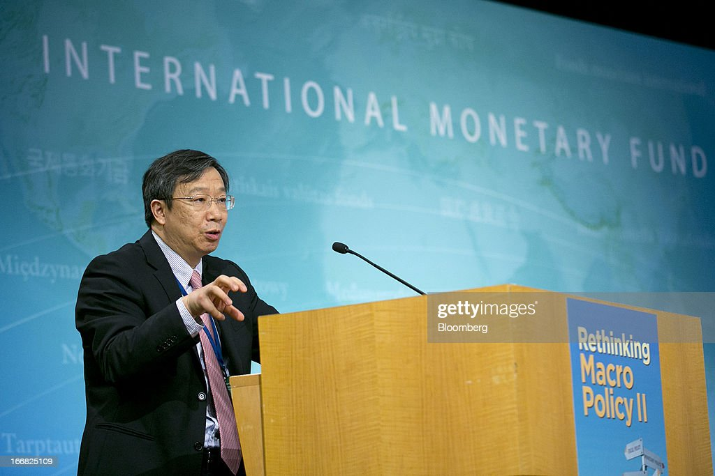 Yi Gang, deputy governor of the People's Bank of China, speaks at a macro policy discussion during the International Monetary Fund (IMF) and World Bank Group Spring Meetings in Washington, D.C., U.S., on Wednesday, April 17, 2013. As much as 20 percent of non-bank corporate debt in the weakest euro-area economies is unsustainable and may force companies to cut dividends and sell assets, dealing further blows to investor confidence, the IMF said. Photographer: Andrew Harrer/Bloomberg via Getty Images