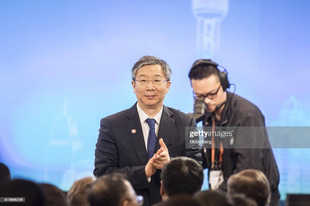 Yi Gang, governor of the People's Bank of China (PBOC), stands during his introduction at the Lujiazui Forum in Shanghai, China, on Thursday, June 14, 2018. China's central bank is studying policies to boost loans to smaller firms, Yi said in a speech to the forum. Photographer: Qilai Shen/Bloomberg via Getty Images