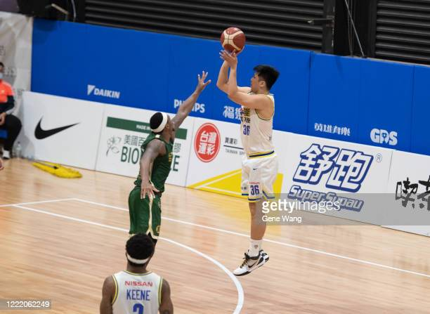 Yi Hui Lin of Yulon Luxgen Dinos attempts to jump shot during the SBL Finals Game Six between Taiwan Beer and Yulon Luxgen Dinos at Hao Yu Trainning...