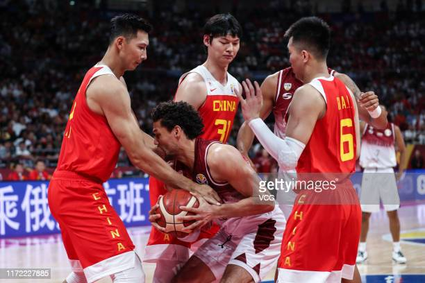 Yi Jianlian of China and Michael Carrera of Venezuela fight for the ball during FIBA World Cup 2019 Group A match between Venezuela and China at...