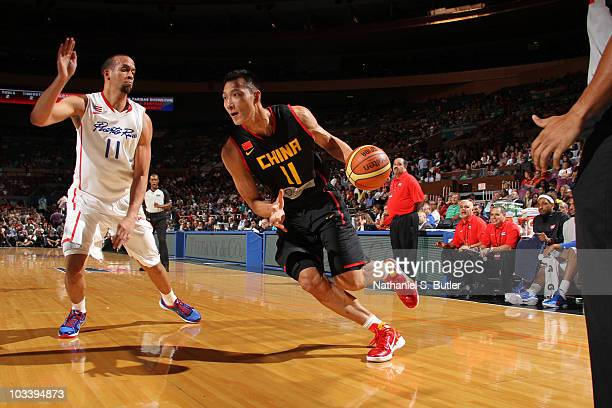 Yi Jianlian of China drives against Ricardo Sanchez of Puerto Rico at Madison Square Garden on August 15, 2010 in New York City. NOTE TO USER: User...