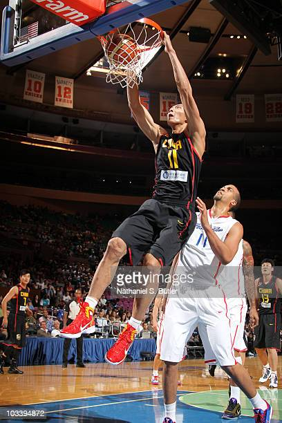 Yi Jianlian of China dunks against Ricardo Sanchez of Puerto Rico at Madison Square Garden on August 15, 2010 in New York City. NOTE TO USER: User...