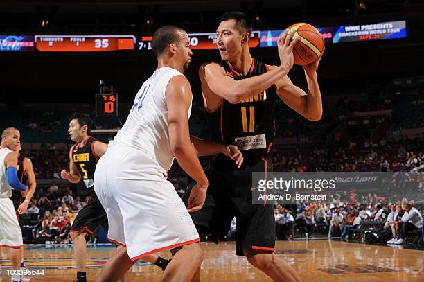 Yi Jianlian of China looks to shoot against Ricardo Sanchez of the Puerto Rico on August 15, 2010 at Madison Square Garden in New York City. NOTE TO...