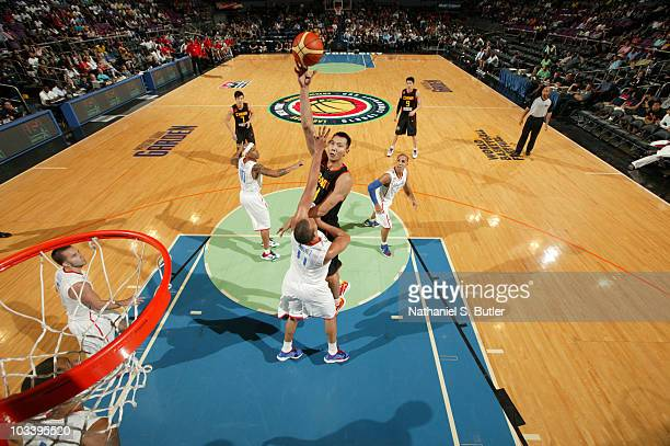 Yi Jianlian of China shoots against Ricardo Sanchez of Puerto Rico at Madison Square Garden on August 15 2010 in New York City NOTE TO USER User...