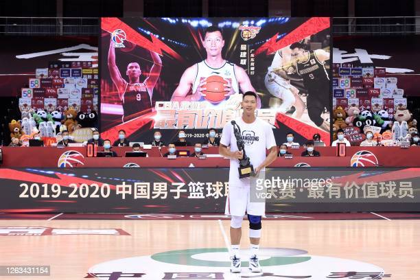 Yi Jianlian of Guangdong Southern Tigers poses with trophy ahead of 2019/2020 Chinese Basketball Association League playoff quarterfinals between...