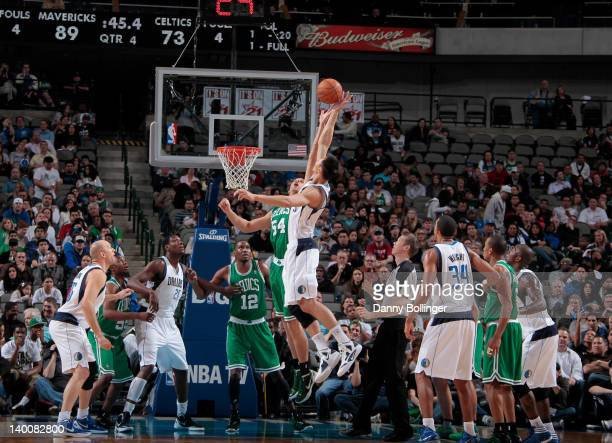 Yi Jianlian of the Dallas Mavericks attempts a shot against Greg Stiemsma of the Boston Celtics on February 20 2012 at the American Airlines Center...