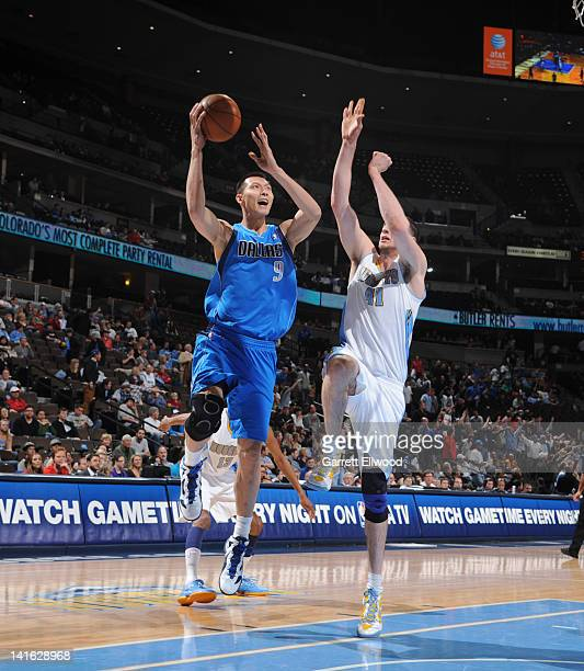 Yi Jianlian of the Dallas Mavericks drives to the basket against Kosta Koufos of the Denver Nuggets on March 19 2012 at the Pepsi Center in Denver...