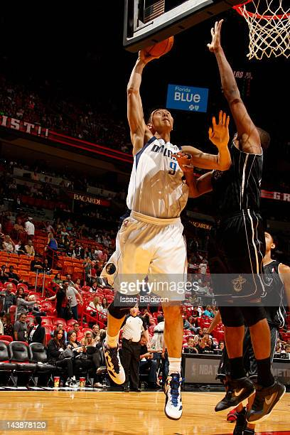 Yi Jianlian of the Dallas Mavericks goes to the basket against Dexter Pittman of the Miami Heat during the game on March 29 2012 at American Airlines...