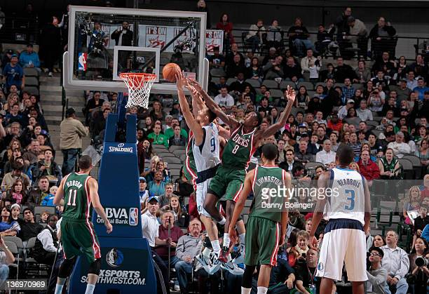 Yi Jianlian of the Dallas Mavericks goes to the rim for a dunk against Larry Sanders of the Milwaukee Bucks on January 13 2012 at the American...