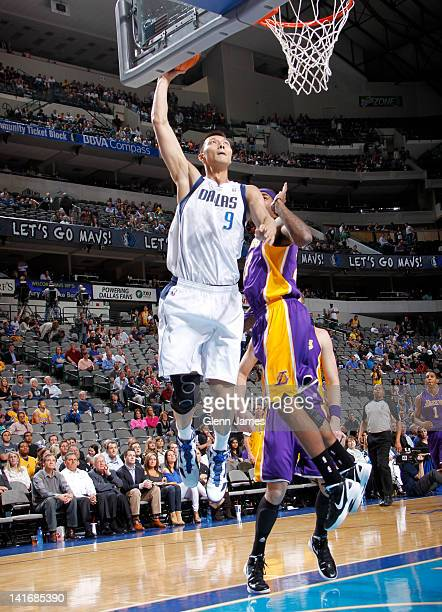 Yi Jianlian of the Dallas Mavericks goes up for the dunk against Jordan Hill of the Los Angeles Lakers on March 21 2012 at the American Airlines...