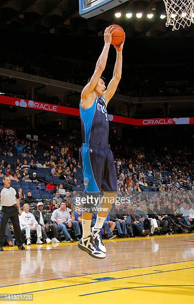 Yi Jianlian of the Dallas Mavericks grabs the rebound against the Golden State Warriors on March 10 2012 at Oracle Arena in Oakland California NOTE...