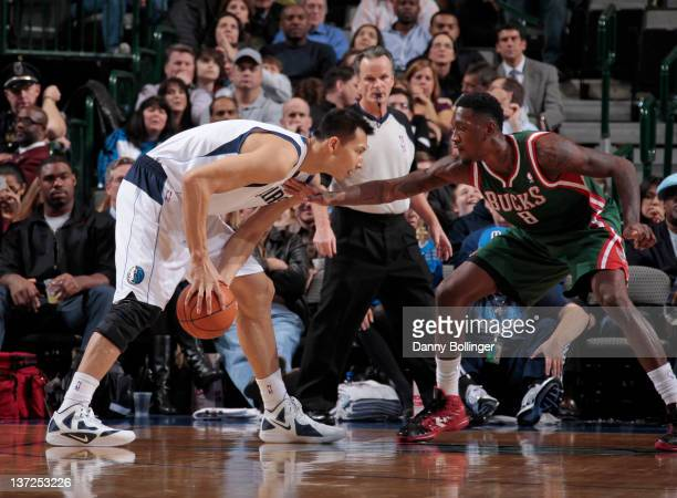 Yi Jianlian of the Dallas Mavericks looks to score against Larry Sanders of the Milwaukee Bucks on January 13 2012 at the American Airlines Center in...
