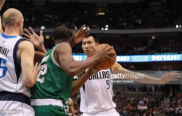 Yi Jianlian of the Dallas Mavericks plays defense against the Boston Celtics at American Airlines Center on February 20 2012 in Dallas Texas NOTE TO...
