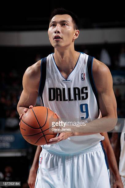 Yi Jianlian of the Dallas Mavericks shoots a free throw against the Milwaukee Bucks on January 13 2012 at the American Airlines Center in Dallas...