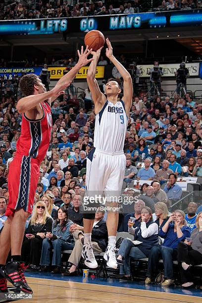 Yi Jianlian of the Dallas Mavericks shoots a jumper against Kris Humphries of the New Jersey Nets on February 28 2012 at the American Airlines Center...