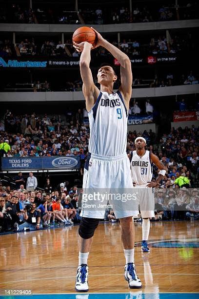 Yi Jianlian of the Dallas Mavericks takes a foul shot against the New York Knicks on March 6 2012 at the American Airlines Center in Dallas Texas...
