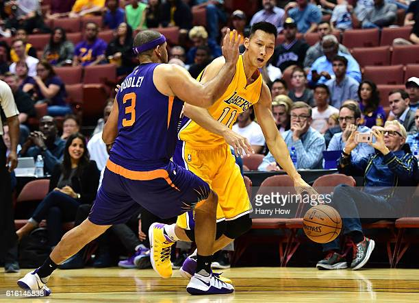 Yi Jianlian of the Los Angeles Lakers attempts to dribble around Jared Dudley of the Phoenix Suns during a preseason game at Honda Center on October...