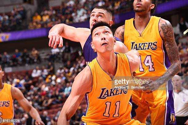 Yi Jianlian of the Los Angeles Lakers boxes out against the Phoenix Suns during a preseason game on October 21 2016 at Honda Center in Anaheim...