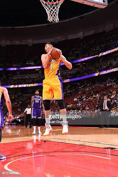 Yi Jianlian of the Los Angeles Lakers grabs the rebound against the Sacramento Kings during a preseason game on October 4 2016 at Honda Center in...
