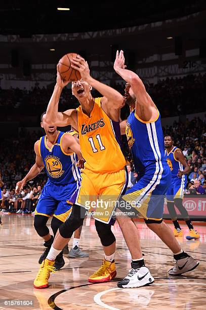 Yi Jianlian of the Los Angeles Lakers handles the ball against the Golden State Warriors on October 19 2016 at Valley View Casino Center in San Diego...