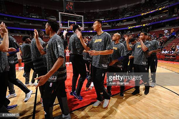 Yi Jianlian of the Los Angeles Lakers high fives teammates before a preseason game against the Sacramento Kings on October 4 2016 at Honda Center in...