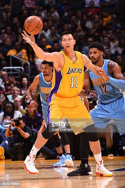 Yi Jianlian of the Los Angeles Lakers posts up against the Denver Nuggets during a preseason game on October 7 2016 at STAPLES Center in Los Angeles...