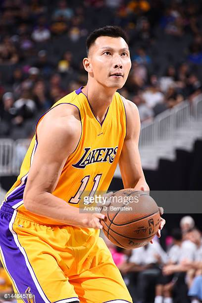 Yi Jianlian of the Los Angeles Lakers shoots a free throw against the Sacramento Kings on October 13 2016 at the TMobile Arena in Las Vegas Nevada...