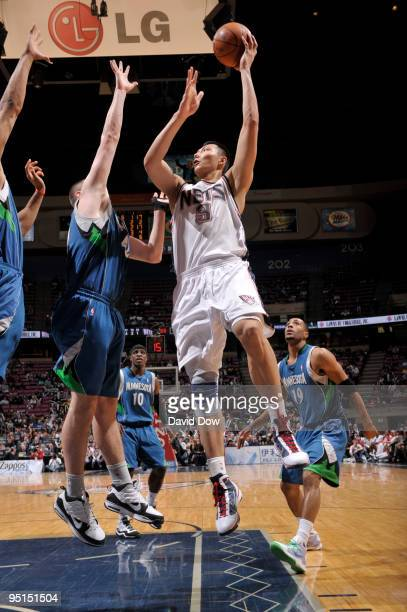 Yi Jianlian of the New Jersey Nets shoots against the Minnesota Timberwolves during the game on December 23 2009 at the Izod Center in East...