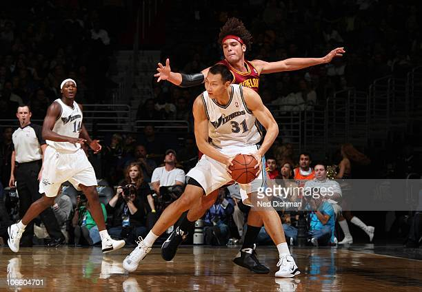 Yi Jianlian of the Washington Wizards backs down against Anderson Varejao of the Cleveland Cavaliers at the Verizon Center on November 6 2010 in...