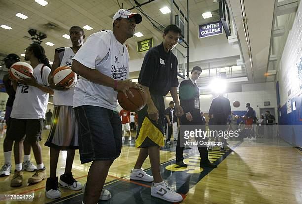 Yi Jianlian works with Scott Pedro of Statan Island during a session of passing drills