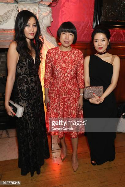 Yi Liu Angelica Cheung and Xiao Feng Feng attend the Wendy Yu's Chinese New Year celebration at Kensington Palace on January 31 2018 in London England