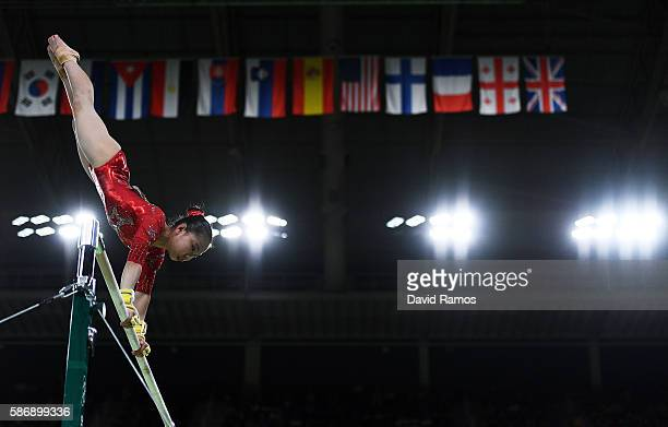 Yi Mao of China competes on the uneven bars during the Women's qualification for Artistic Gymnastics on Day 2 of the Rio 2016 Olympic Games at the...
