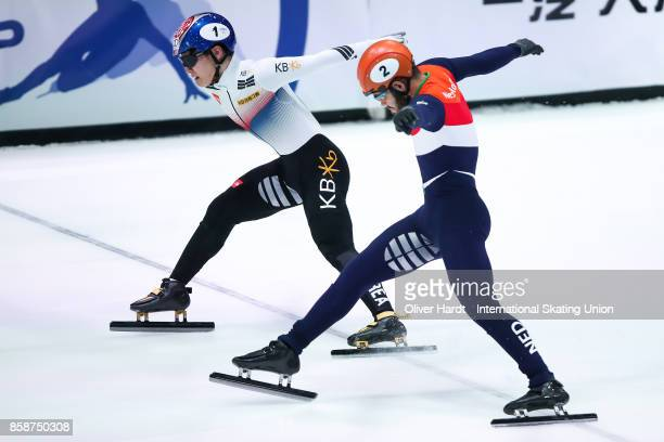 Yi Ra Seo of Korea and Sjinkie Knegt of Netherlands compete in the Mens 500m semi finals race during the Audi ISU World Cup Short Track Speed Skating...