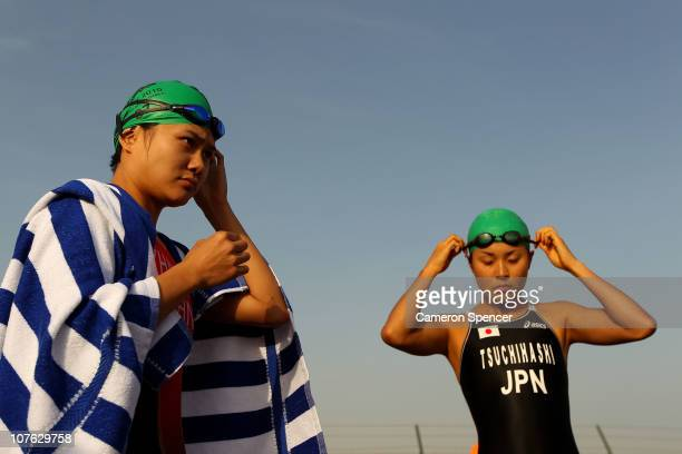 Yi Zhang of China and Akane Tsuchihashi of Japan prepare for the start of the Women's Triathlon event at North Al Hail during day nine of the 2nd...